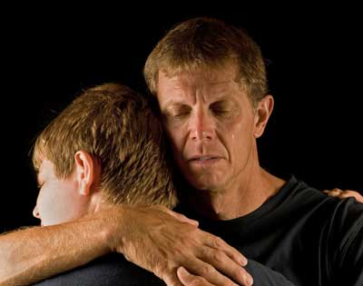 father-and-son-in-emotional-embrace-000011923735_small