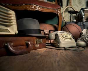 Old items - phone, brief case hat ball.