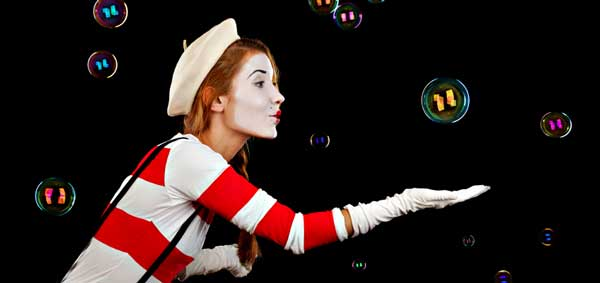 Female mime artist catching bubbles
