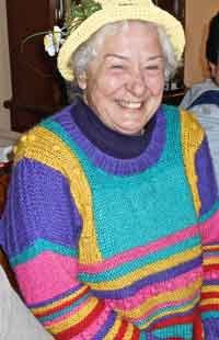 Susan in a bright coloured jumper