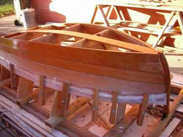 A wooden boat in the process of being built