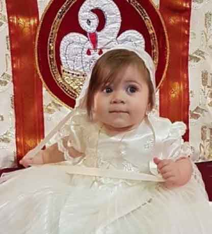 little girl in white christening gown