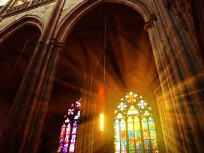 Sun sining through a stained glass window