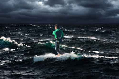 Man surfboarding on the waves